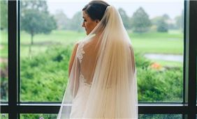 A bride overlooking the grounds from our lobby tiers