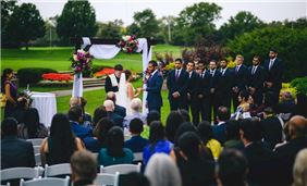 Outdoor wedding ceremony on the grounds of the Hilton Chicago Oak Brook Hills Resort
